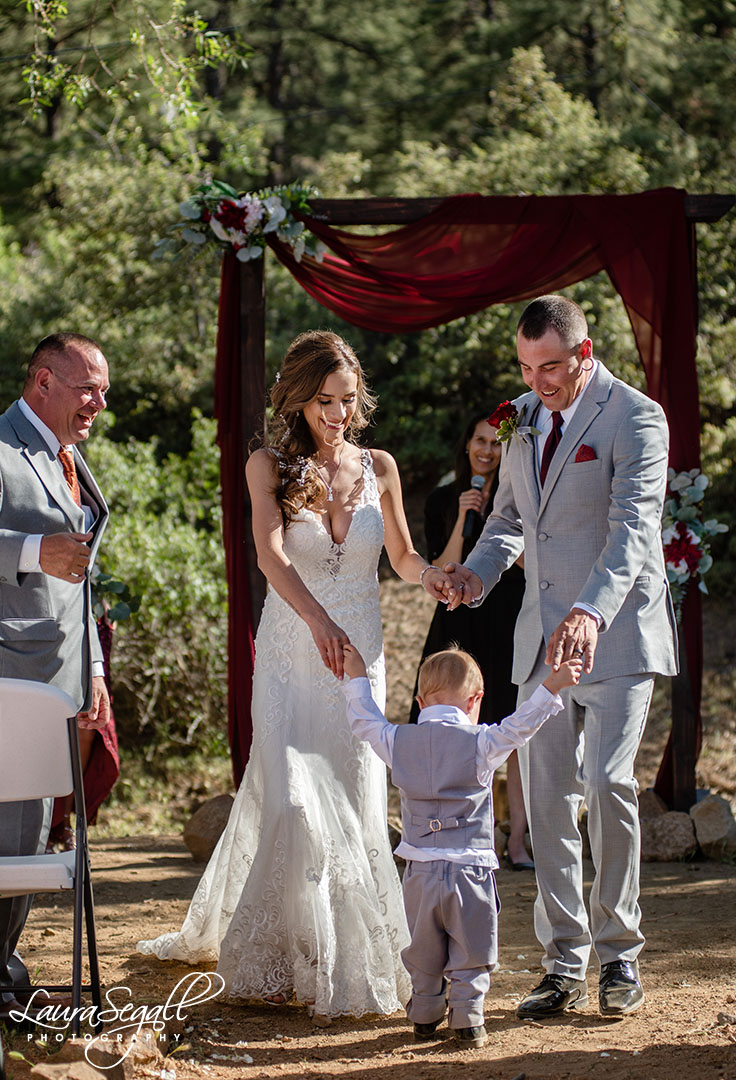 bride and groom and son