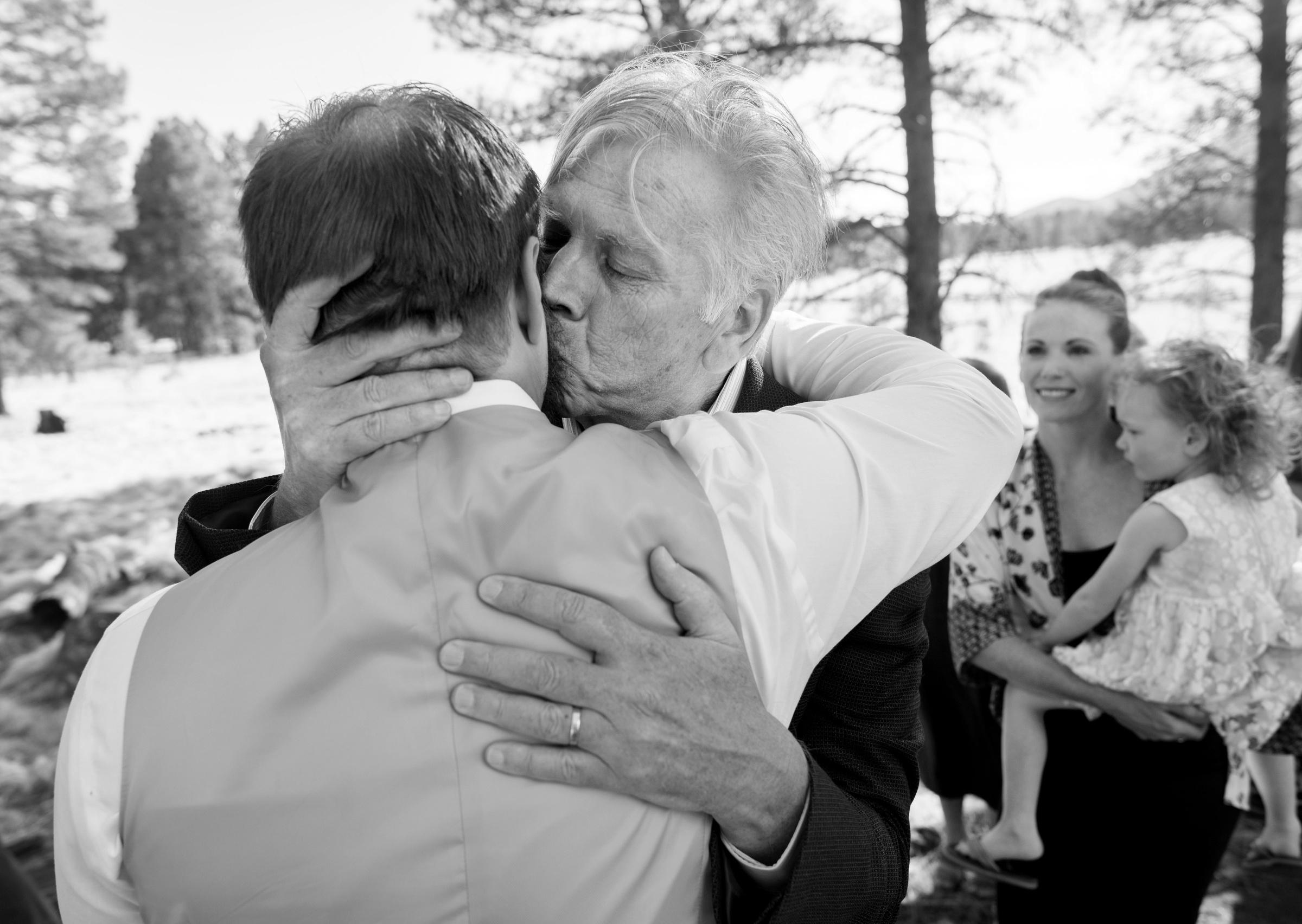 father of the groom hug