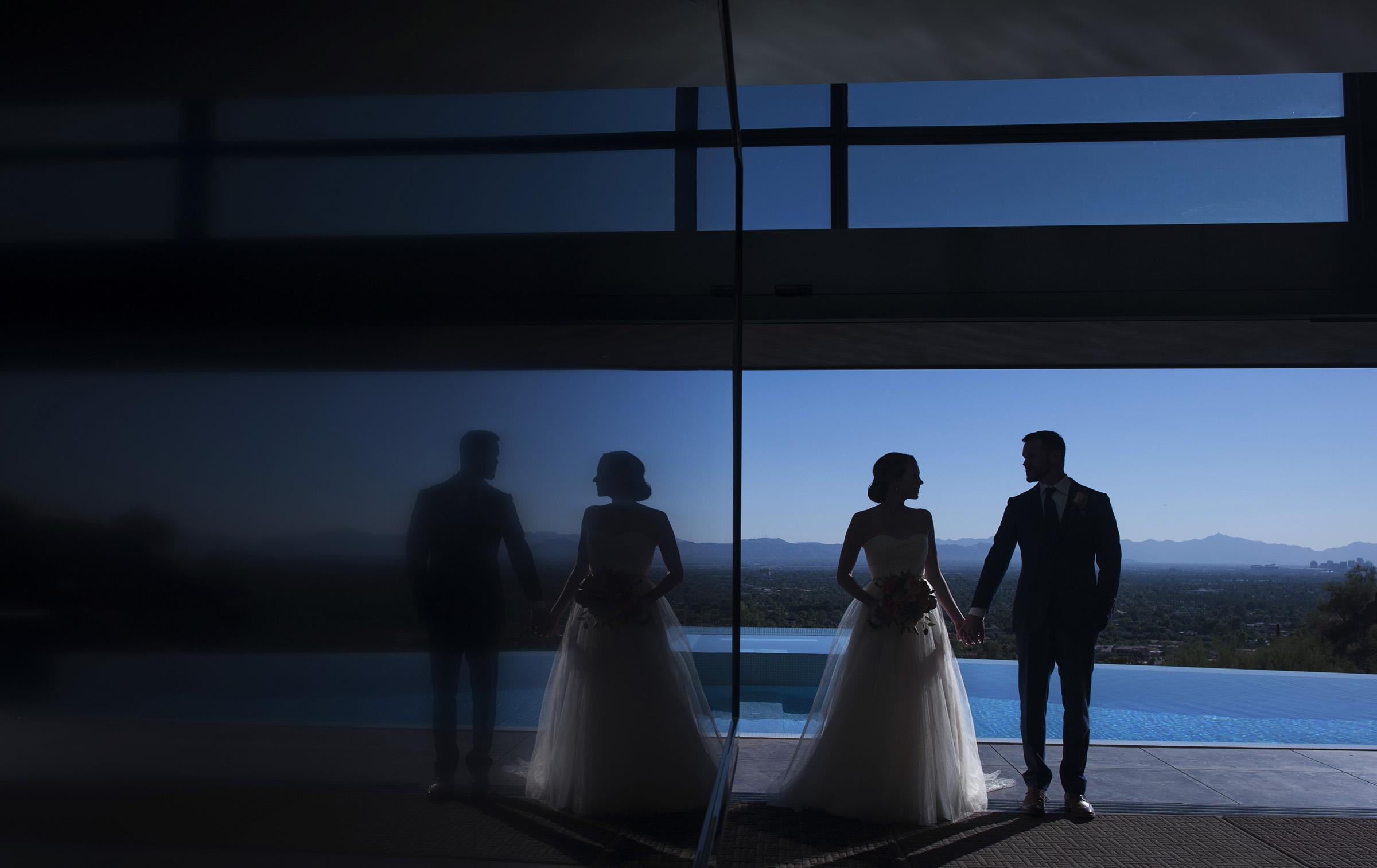 bride and groom blue skies