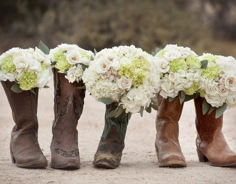cowgirl wedding boots and flowers