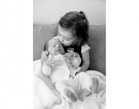newborn baby and her big sister